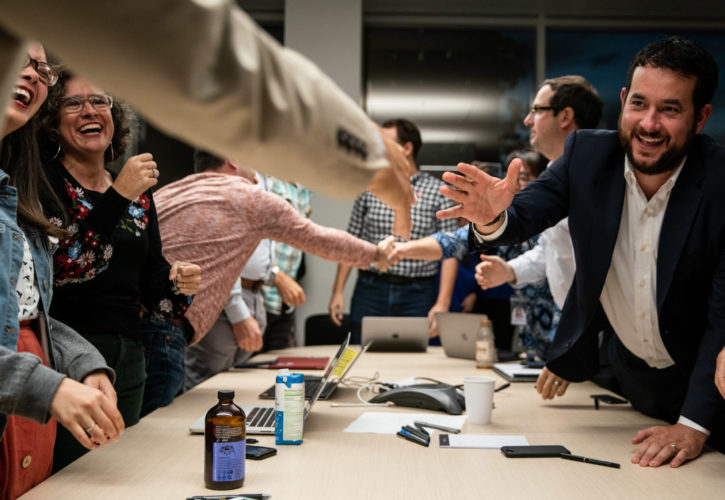 EL SEGUNDO, CALIF. - OCTOBER 16: Members of the LATimes Guild Bargaining Committee and Los Angeles Times management sign a tentatively agreed upon contract at the Los Angeles Times building on Wednesday, Oct. 16, 2019 in El Segundo, Calif. (Kent Nishimura / Los Angeles Times)